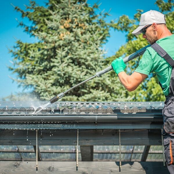 roof and gutters power cleaning using pressure washer